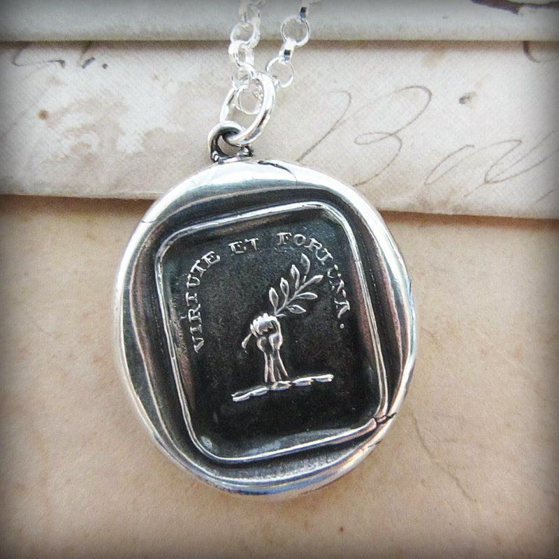 Fortune Favors the Brave wax seal with silver chain.