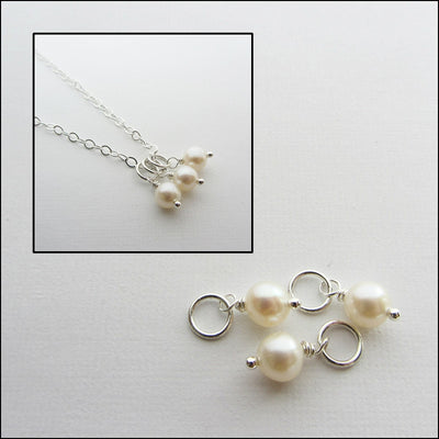 Picture of fresh water pearls separated and attached to a necklace.