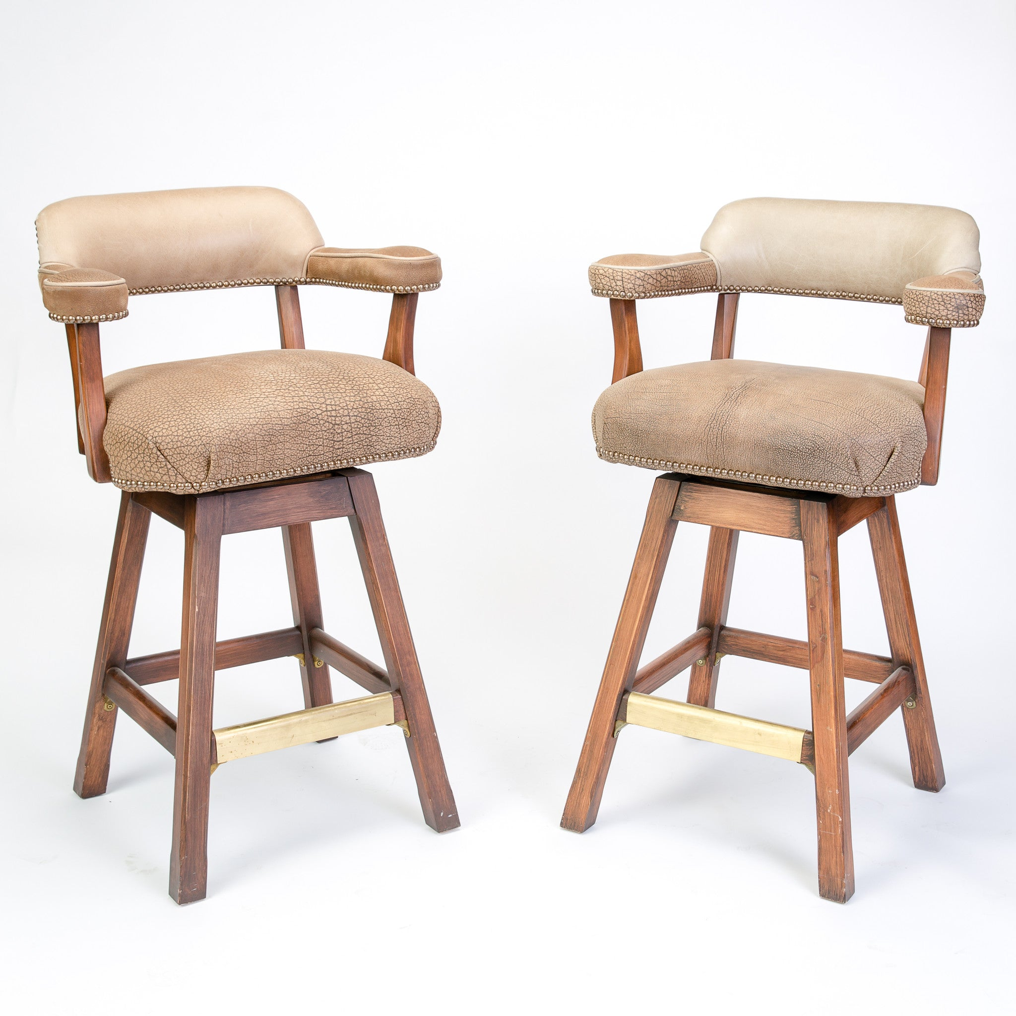 Pair of Swivel Peau Textured Stools With Cowhide Back