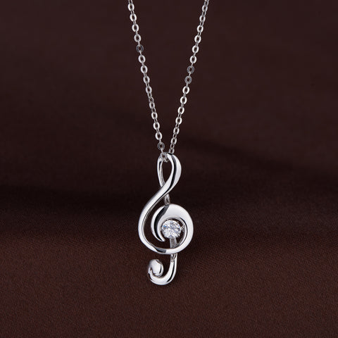 MUSICAL KEY DANCING STONE PENDANT.