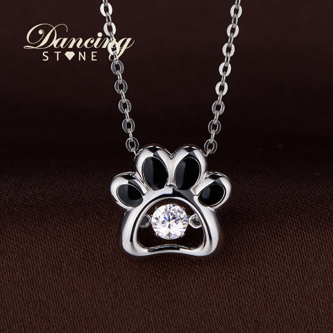 DANCING STONE STERLING SILVER DOG PAW PENDANT.