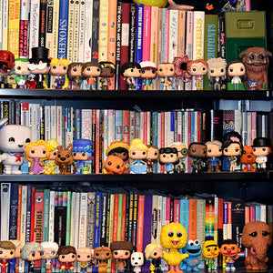 Bookshelf with bobbleheads