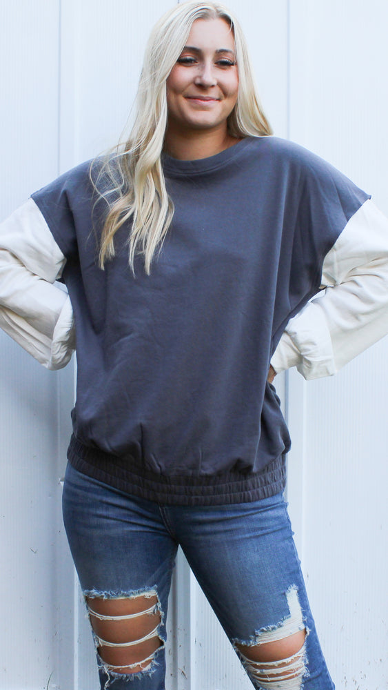 denim and white sweatshirt pullover