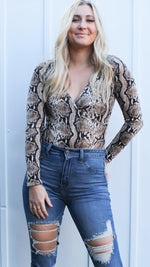 showing off snake print bodysuit