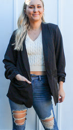 black blazer with roused sleeves