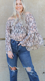 wildly stylish off the shoulder