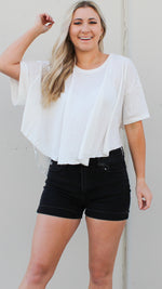 oversized curved hem top in white