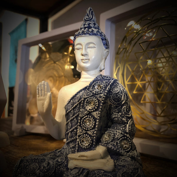 Image of buddha in front of sacred geometry