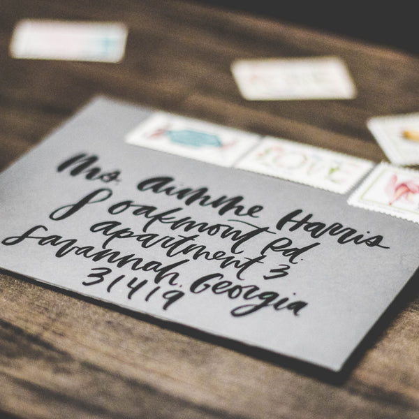 Calligraphy Envelopes in Brush Lettering | Wanderlove Press