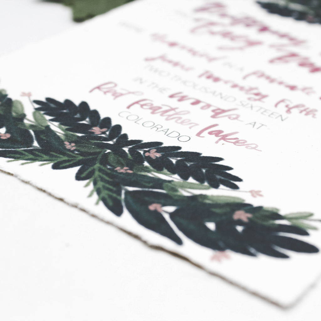 Wedding invitations with a deckled edge and lovely greenery — Wanderlove Press