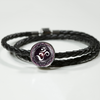 Image of Purple Lotus Flower Om Symbol Double Braided Leather Charm Bracelet - Lyghtt
