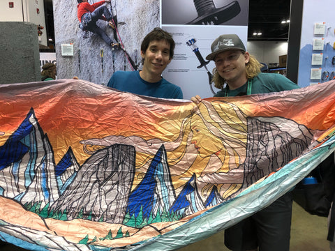 Adam Eggleston with Alex Honnold at Outdoor retailer 2019 Denver showing Madera Outdoor Company's new Art hammocks, A collaboration with Chris Benchetler and Skye Walker.