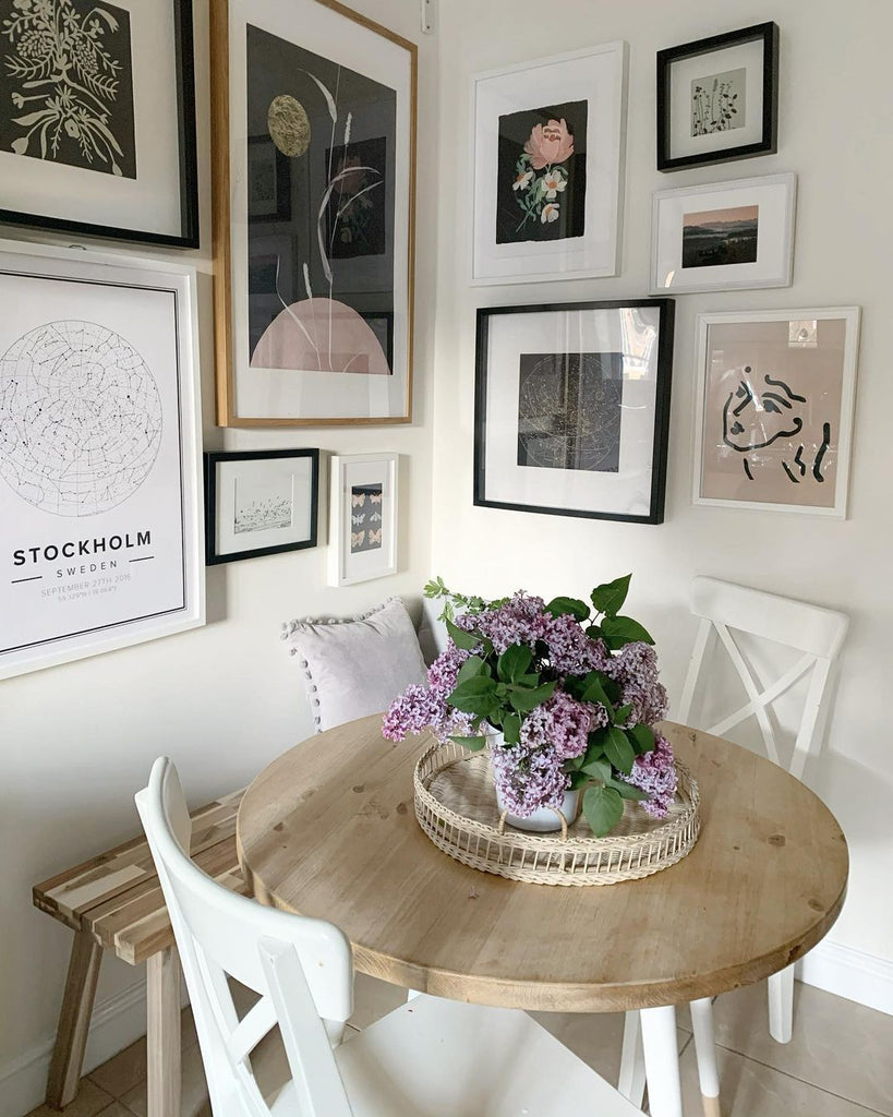 Beautiful kitchen table corner with an eclectic gallery wall