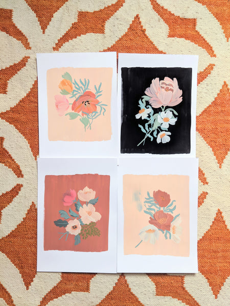 Original floral paintings laid out on the studio floor!