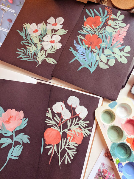 Annie's experiments painting florals directly onto black paper