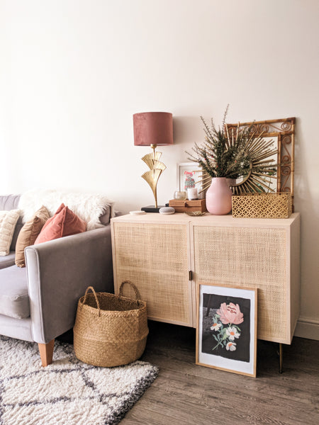 grey, rattan and pink velvet living room