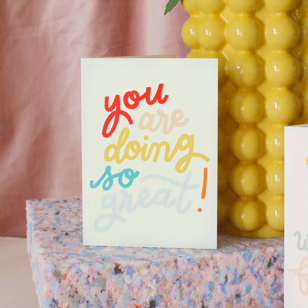 """rainbow lettered and embossed card that reads """"You are doing so great!"""""""