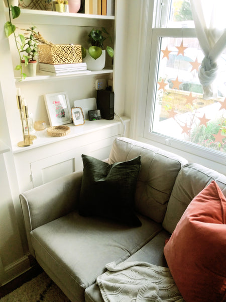 Cosy compact living room corner with built in shelving