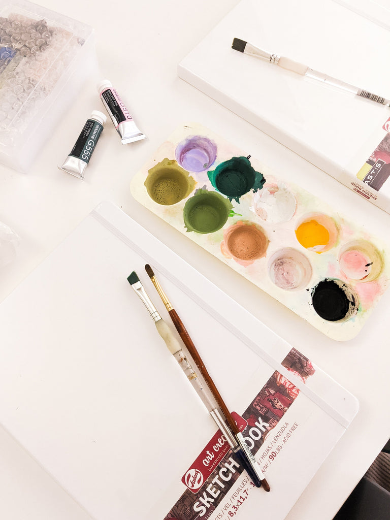 art supplies laid out on a table ready to be used
