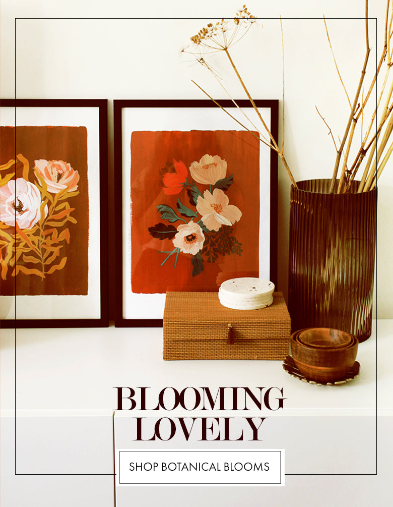 BLOOMING LOVELY - Shop Botanical Blooms Collection (image: floral prints propped up on a white cabinet)