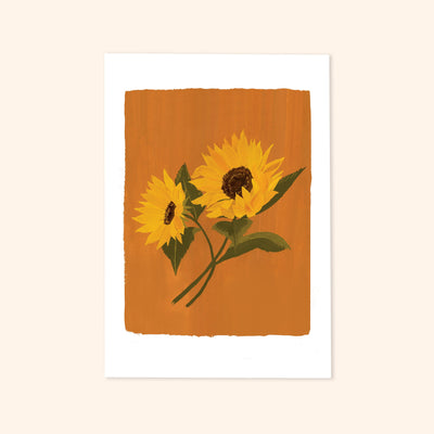 A print of two yellow painted sunflowers on a warm orange background