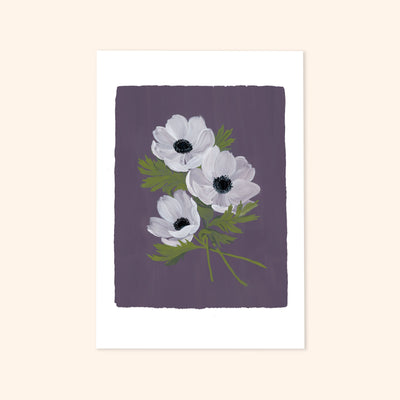 A print of painted white anemone flowers against a blue/purple background