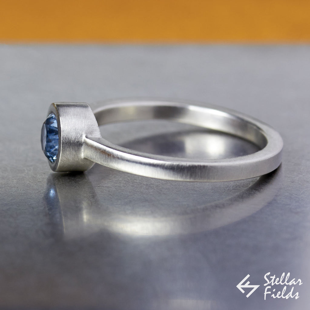 5mm Round Blue Montana Sapphire Modern Round Bezel Set Engagement Ring in Sterling Silver 14k Gold Platinum Stellar Fields Jewelry