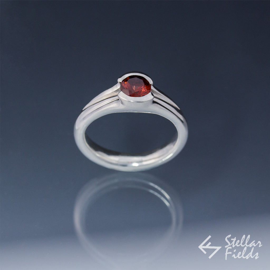 Tension Set Unique Round Red Garnet Ring - Stellar Fields