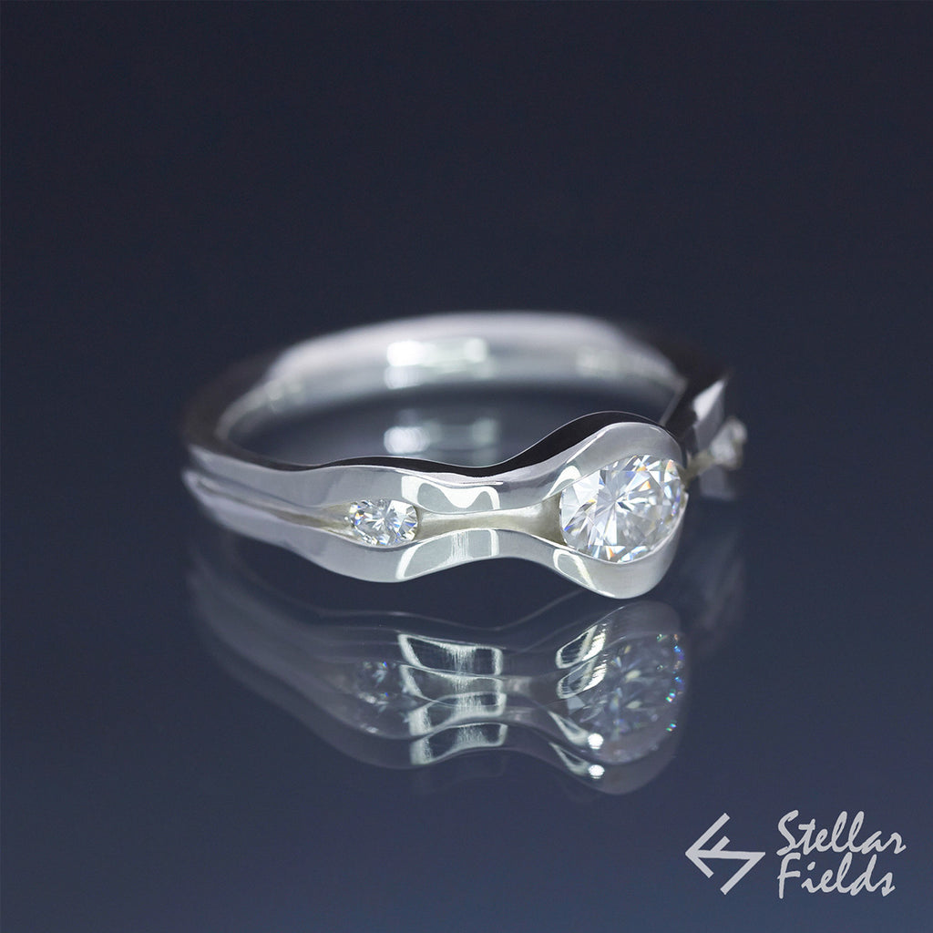 5mm Round Diamond with Two Accent Stones, Modern Wave Channel Set Engagement Ring in White Gold Platinum