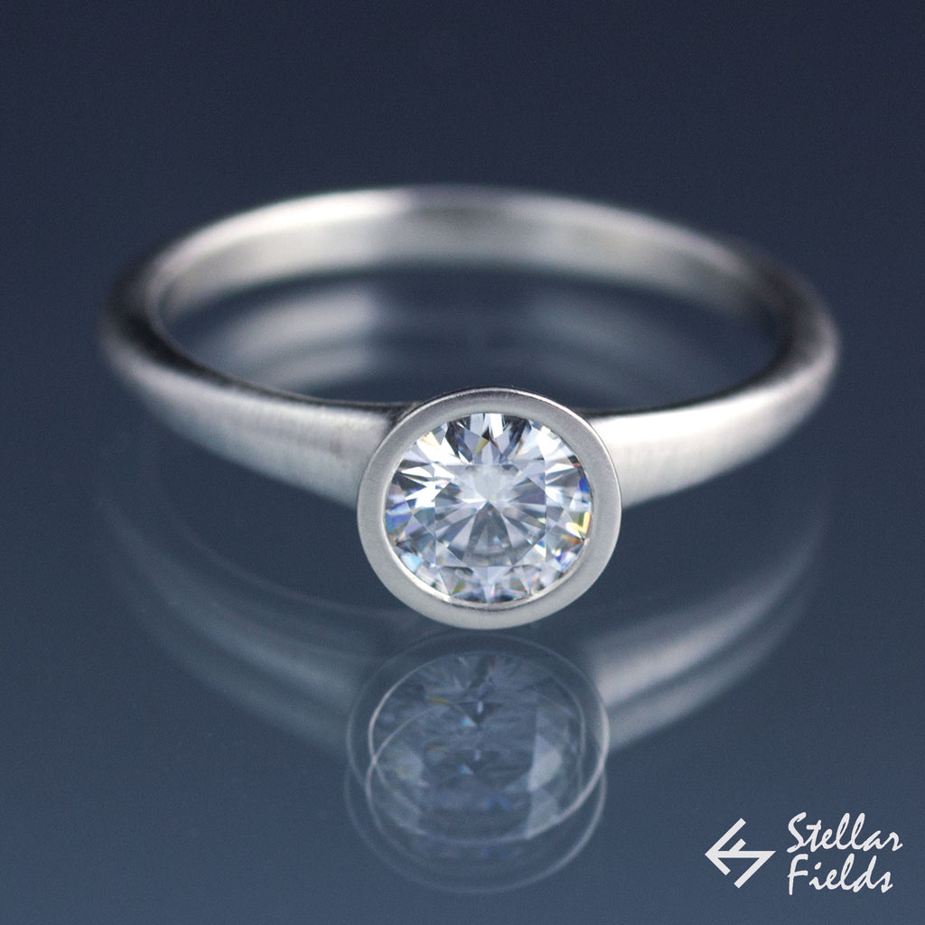 Forever One™ Round Moissanite Solitaire Bezel Engagement Ring - Stellar Fields
