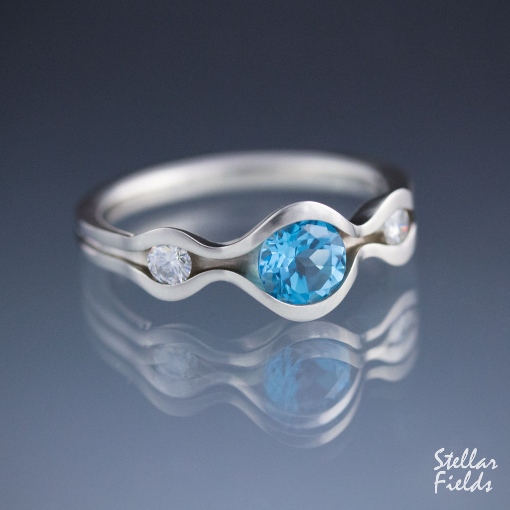 Swiss Blue Topaz Wave Ring Three Stone Ring Canadian Diamonds Platinum Stellar Fields Jewelry