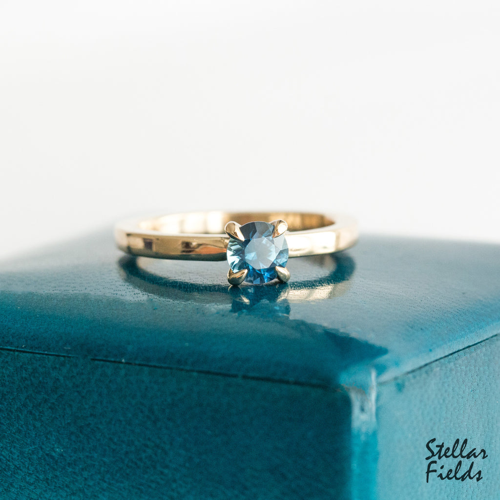 Teal Sapphire prong ring solitaire engagement ring 14k yellow gold Stellar Fields Jewelry