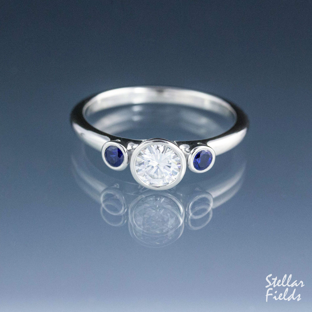 Three Stone Bezel Engagement Ring Moissanite Engagement Ring Blue Sapphire Stellar Fields Jewelry