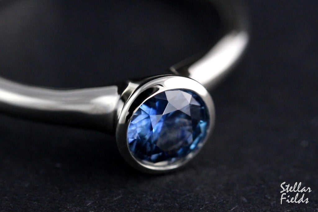 cornflower blue montana sapphire bezel engagement ring platinum