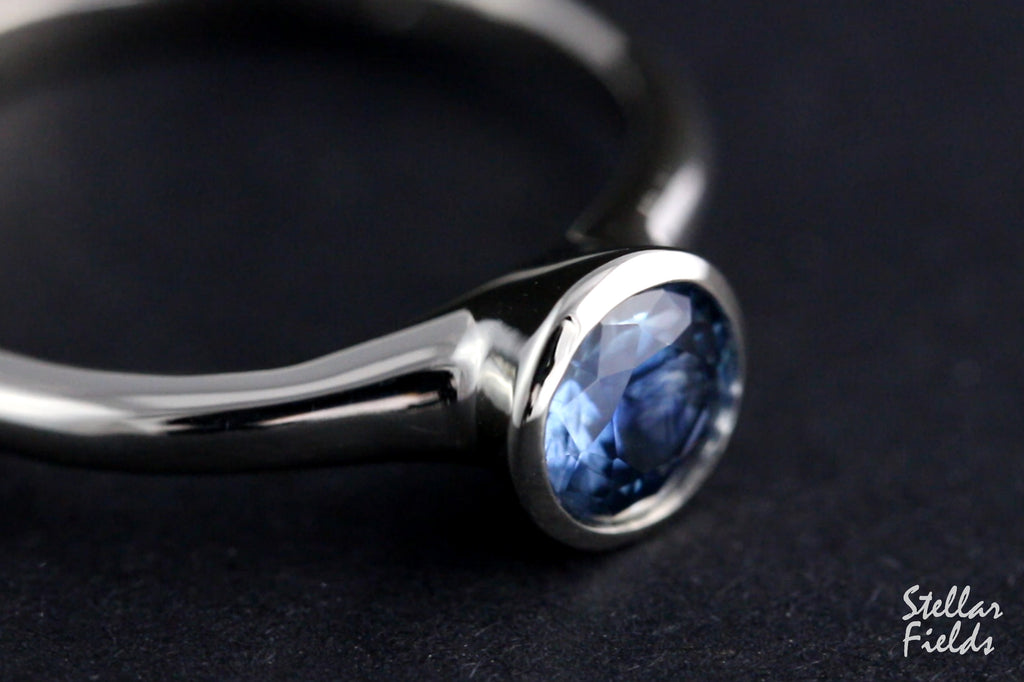 cornflower blue sapphire bezel engagement ring platinum
