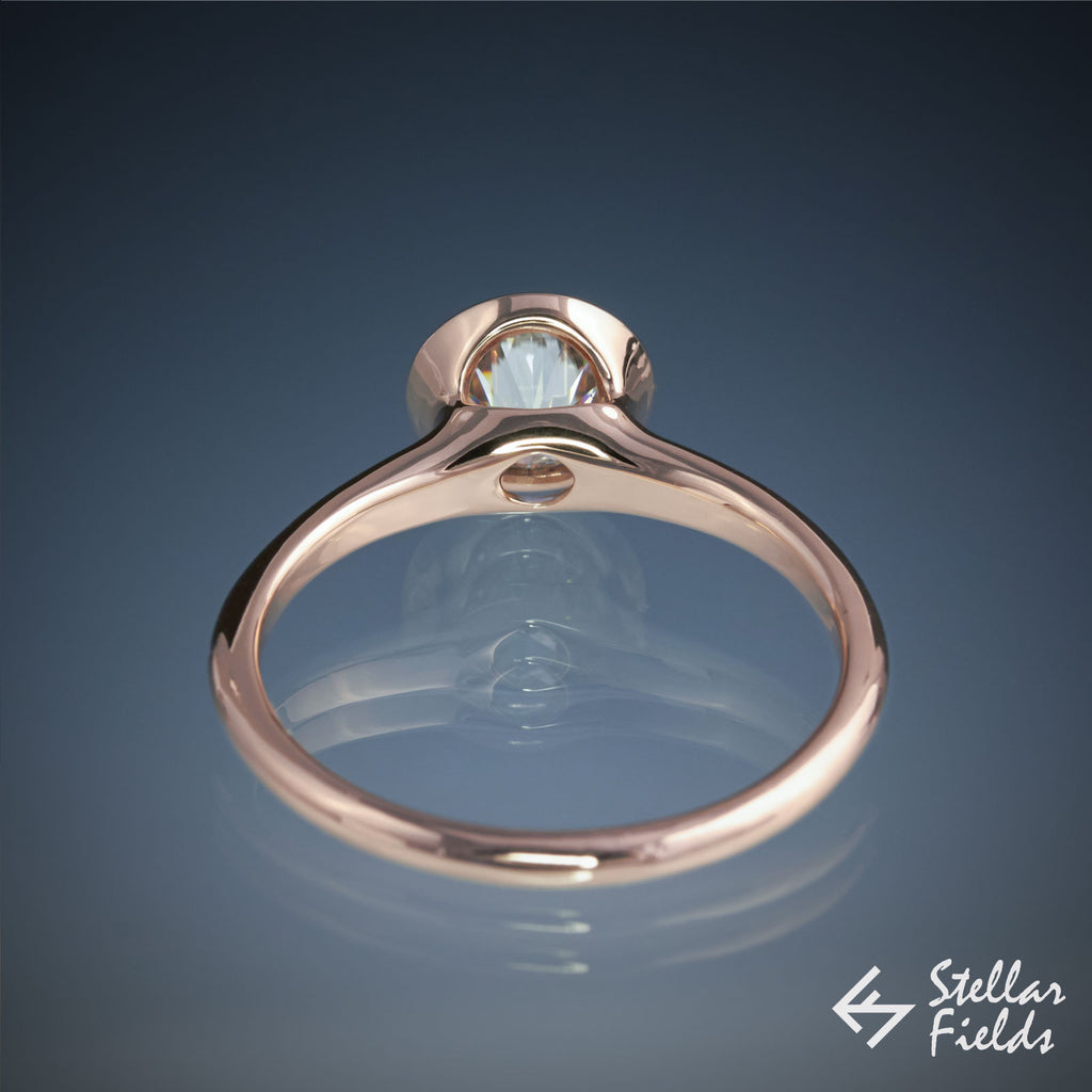6.5mm Round diamond tapered peekaboo cutout full bezel set engagement ring in 14k rose gold