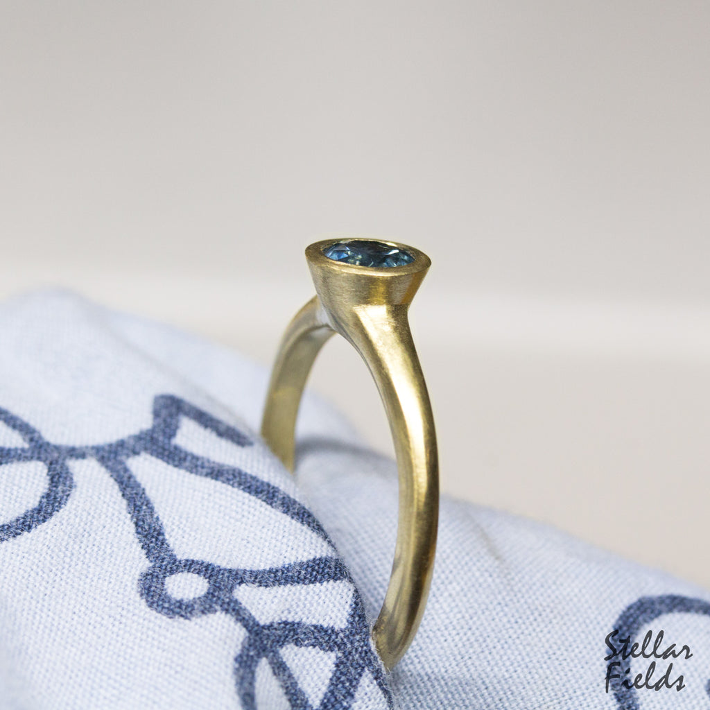 modern bezel engagement ring blue sapphire 14k yellow gold Stellar Fields Jewelry