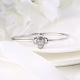 Sterling Silver Four Petals Flower Diamond Inlaid Dancing Diamond Bangle