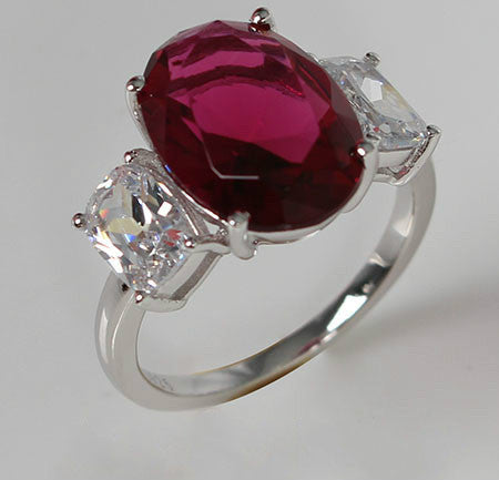 Oval Shaped Ruby with Side Crystal Silver Engagement Ring