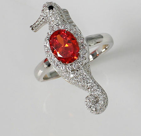 Oval Shaped Orange-Red Ruby Hippocampus Engagement Ring