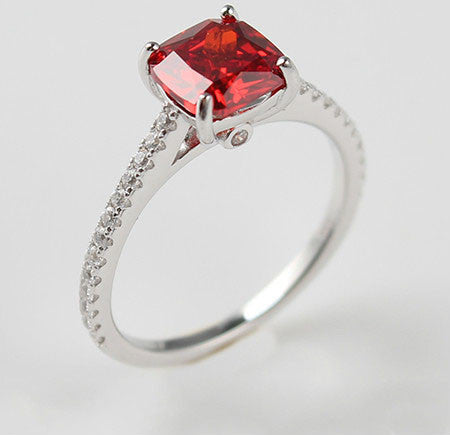 Solitary Step Cut Orange-Red Ruby Engagement Ring