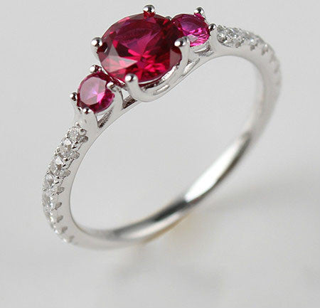 Round Shaped Side Ruby Diamonds Engagement Ring