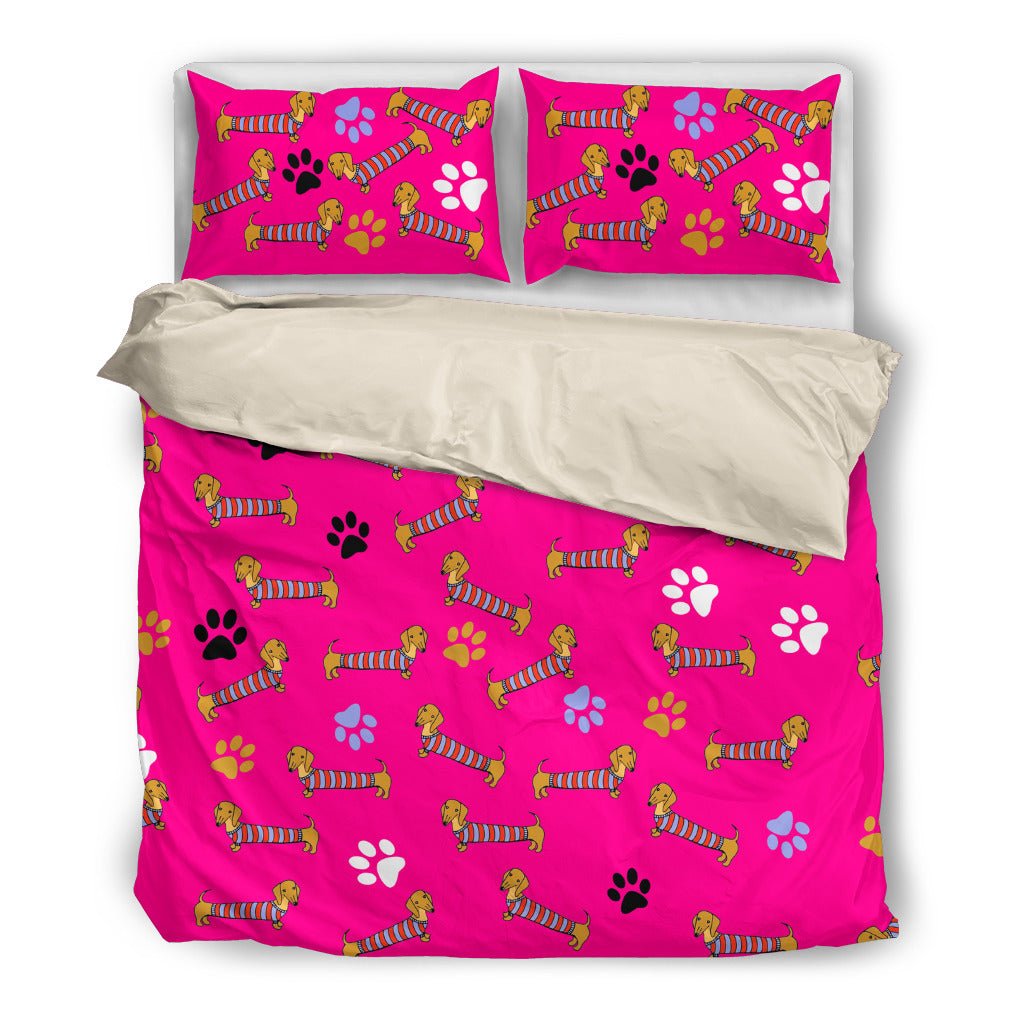 Pink bedding set with duchshunds