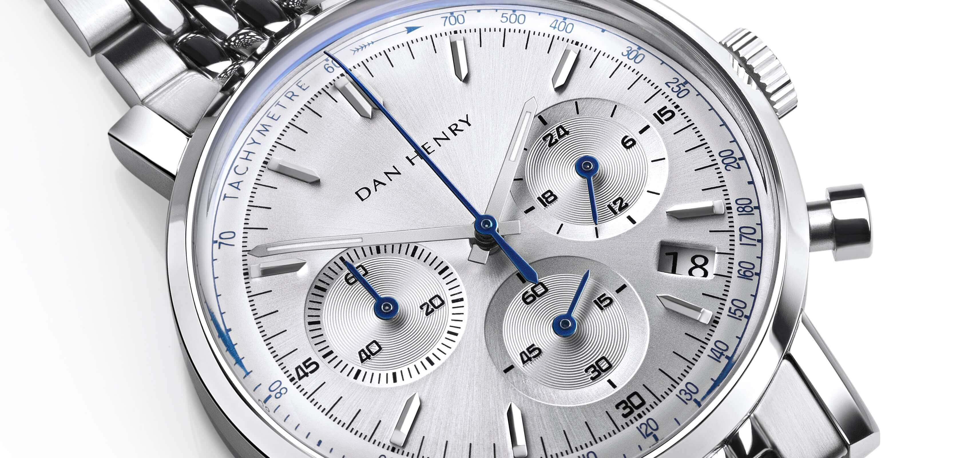 <h3>Dial</h3><p>Silver dial, with date window, black numbers and blue tachymeter</p>