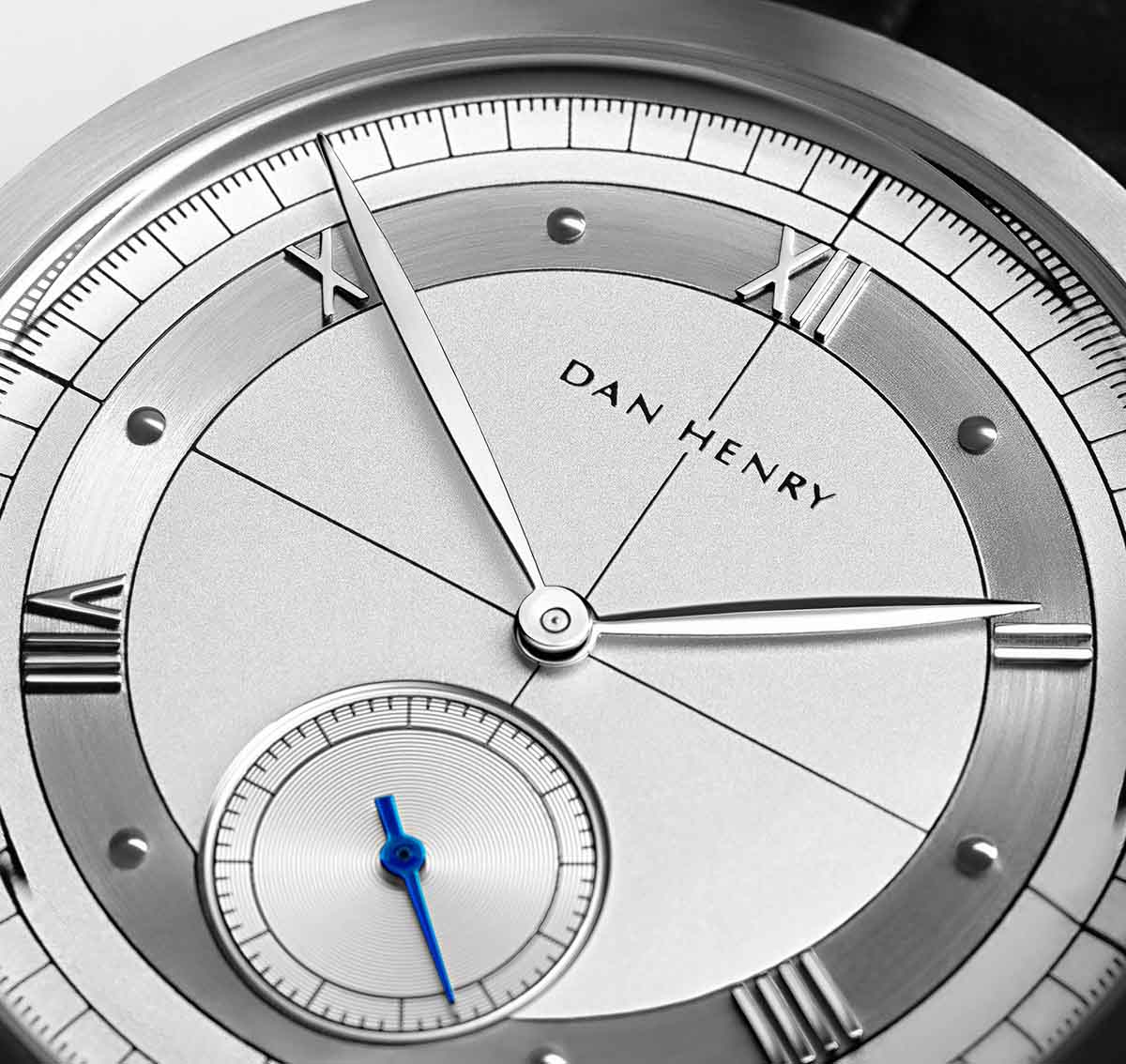<h3>Subdial</h3>Silver Guilloché subdial with blue hands