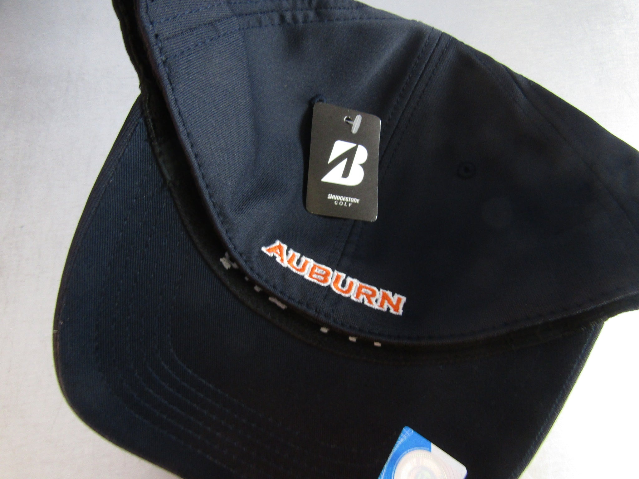 4cd08a922d6 ... Bridgestone Golf NCAA Performance Cap Hat One Fit Fitted Choose Your  Team ...