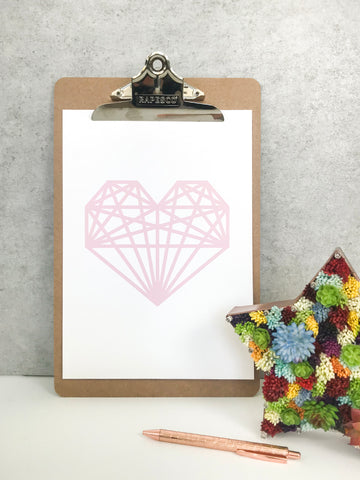Geometric heart print displayed using a clipboard - 5 ways to hang your prints without frames by Made by Aiza
