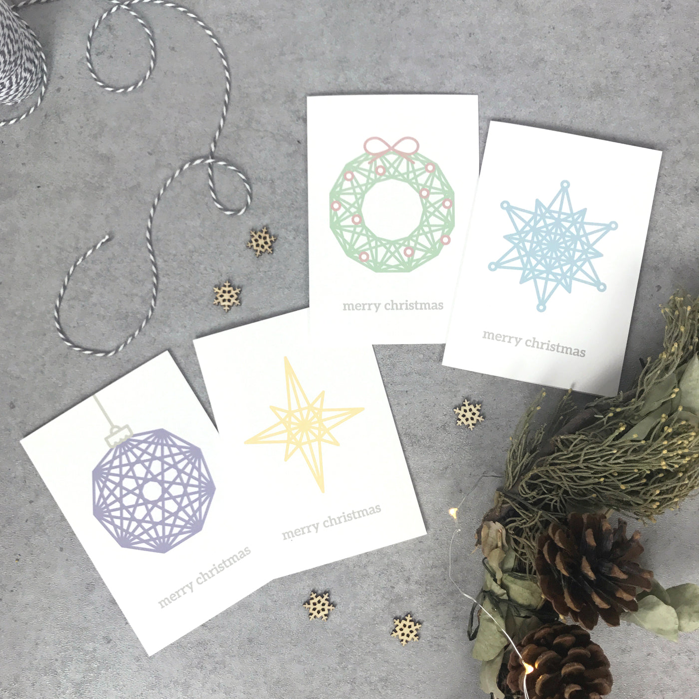 Modern Christmas cards (pack of 4): snowflake, wreath, bauble, star