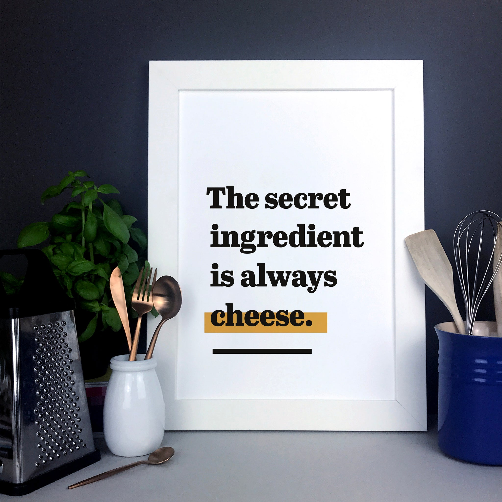 'The secret ingredient is always cheese.' Funny cheese quote typography print for the kitchen