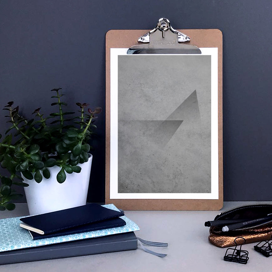 Abstract print with a triangle design on a concrete background